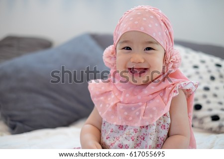 cute muslim baby hijab stock photo edit now 617055695 shutterstock