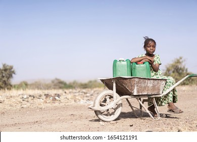 Cute Native African Women Carrying healthful Water in a village