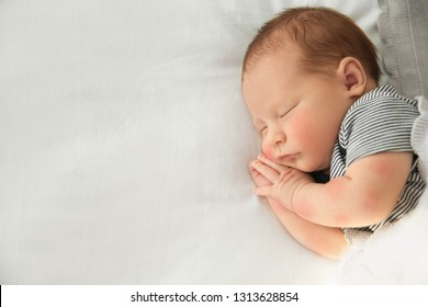 Cute newborn baby with allergy sleeping in bed, top view with space for text
