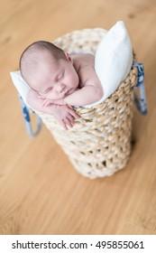 cute newborn baby in a basket.