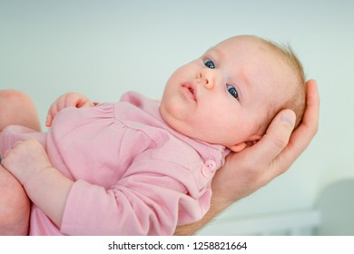 Cute newborn baby girl lying in fathers arms. Fathers Day