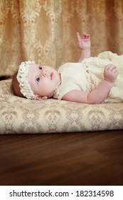 Cute newborn baby girl posing for camera