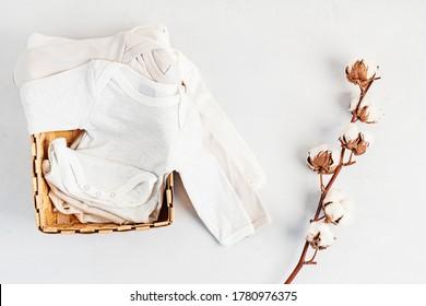 Cute newborn clothes. Organic cotton baby apparel mockup. Flat lay, top view