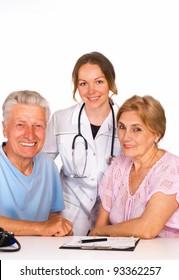 cute nurse stands near the old couple