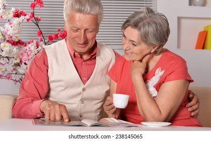 Cute old couple at breakfast at table