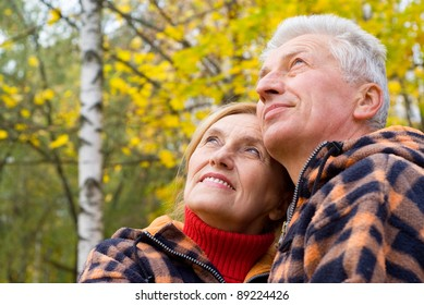 cute old couple posing in autumn park