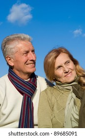 cute old couple posing with the sky on background