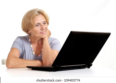 Cute old lady at home on a white background