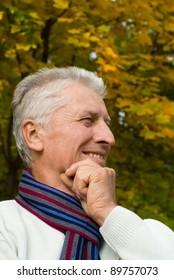 cute old man posing at autumn park