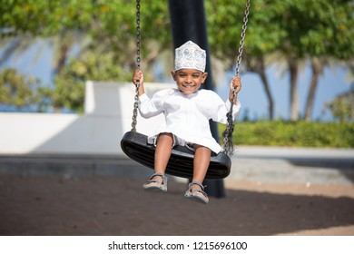 Cute Omani boy playing outdoors