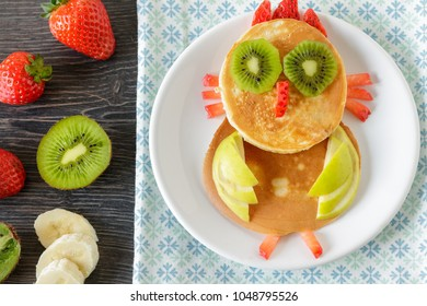 Cute owl homemade pancake with fruits for kids breakfast