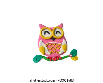 The cute owl is on a branch made from plasticine clay on white background,lovely animal dough