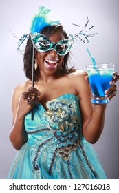 Cute party girl and blue cocktail