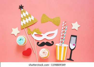 Cute party props, cakes on colorful background, happy new year party celebration and holiday concept