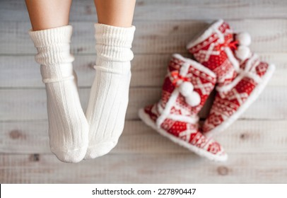 Cute photo of woman's feet with christmas slippers, top view point. Cozy, comfy, soft