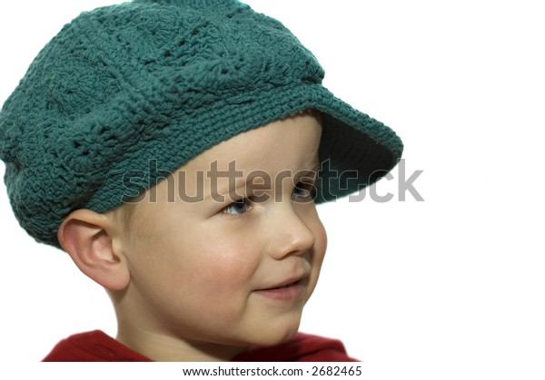 Cute picture of a little 3 year old wearing a green hat.