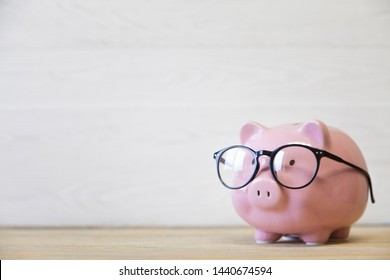 Cute piggy bank on wooden background