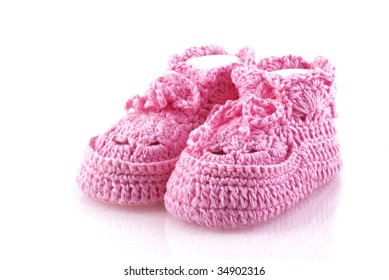 Cute pink baby footwear on a white background.