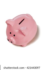 Cute pink piggy bank shot from above on white background with shadow around base