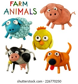 Cute plasticine / clay farm animals collection isolated on white background. Pig, cow, chicken, dog, sheep