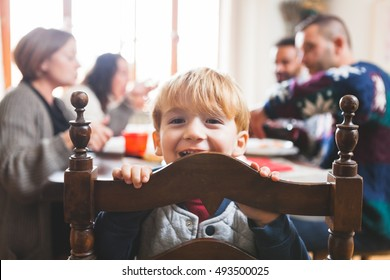 Cute Playful Preschooler Child at Christmas Dinner