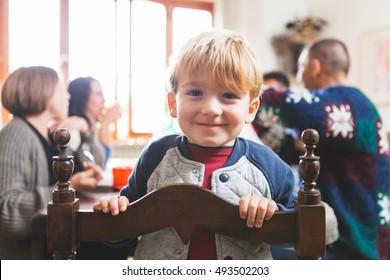 Cute Playful Preschooler Child at Christmas Dinner