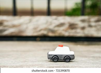 cute police car model toy on wooden floor