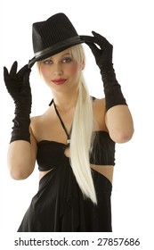 cute portrait of beautiful blond girl with black gloves and hat