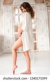 cute pregnant girl in white coat