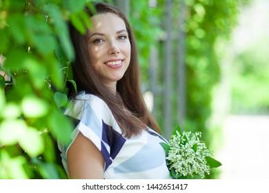 cute pregnant woman in park
