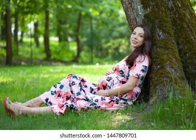 cute pregnant woman walking outdoors