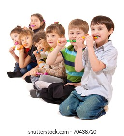 Cute preschool kids group cleaning teeth, isolated