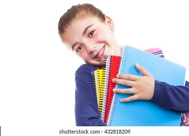 Cute preschool student girl holding notebooks on white background