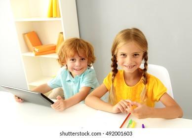 cute preschoolers studying indoors