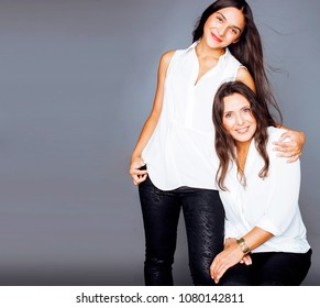 cute pretty teen daughter with mature mother hugging, fashion st