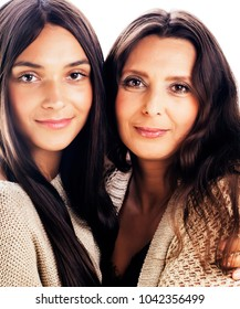 cute pretty teen daughter with real mature mother hugging, fashi