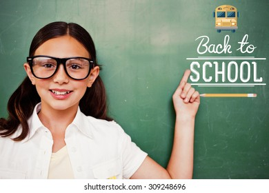 Cute pupil pointing against back to school
