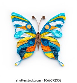Cute quilling butterfly colorful element isolated on white background. Beautiful hand made paper decoration closeup.