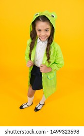 Cute raincoat kids would love. Frog style. Schoolgirl hooded raincoat enjoy fall weather. Rainproof accessories make rainy fall day pleasant. Waterproof accessory. Kid girl happy wear raincoat.