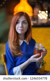 cute redhaired girl drinking tea