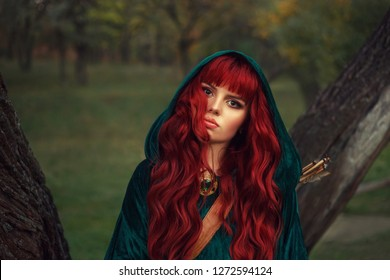 cute red-haired girl, looks into the camera with brown eyes, wearing an emerald raincoat with a hood on her head, has a leather quiver for arrows and an expensive shiny look on her neck. Gothic style