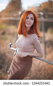 cute redhead girl on the bridge