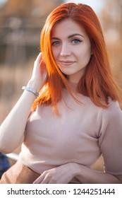 cute redhead girl walking outdoors