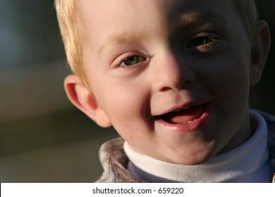 cute redheaded boy portrait, laughing