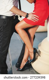 Cute relationship between a man and a woman in a red dress