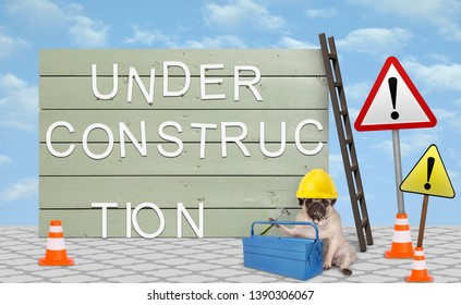 cute repairman worker pug puppy dog with yellow safety helmet, sitting down next to wooden board sign, with text under construction