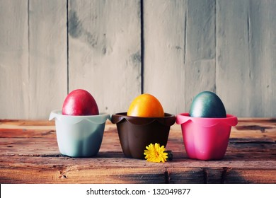 Cute retro photo with easter eggs in the nest