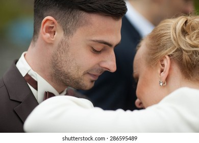 Cute romantic gentle stylish blonde bride with the groom  closeup