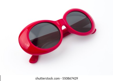 cute round red sunglasses lying diagonally isolated