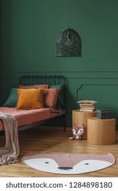Cute rug fox shape like rug on wooden floor of dark green bedroom interior